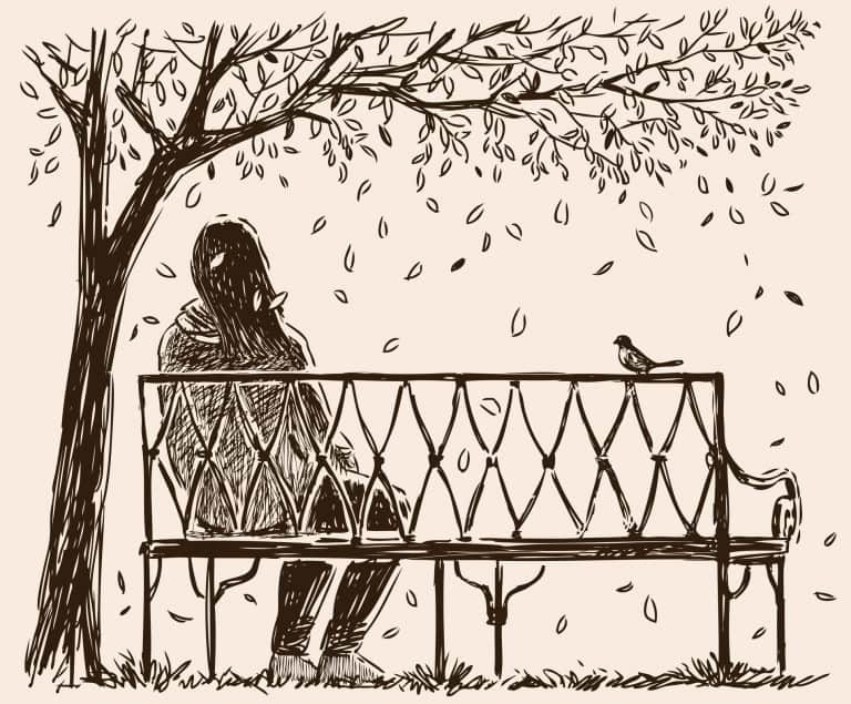 Woman Sitting on a Bench in Autumn