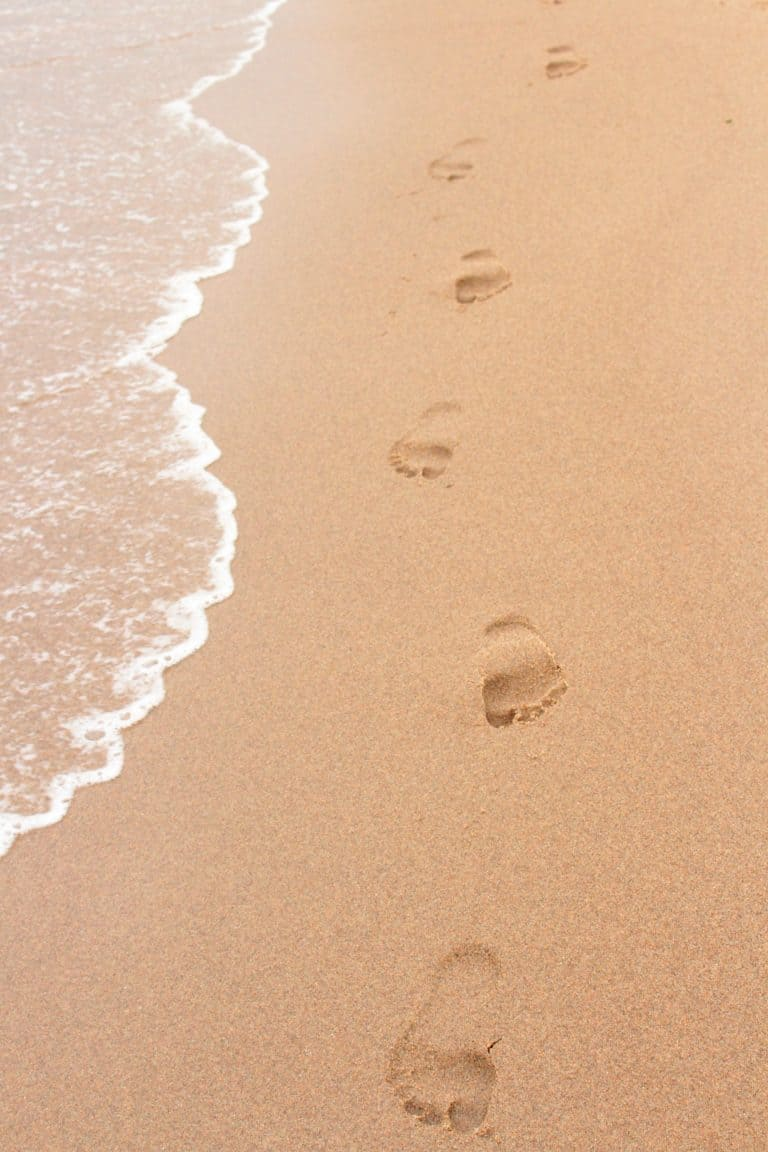 Beach with footprints in the Sand