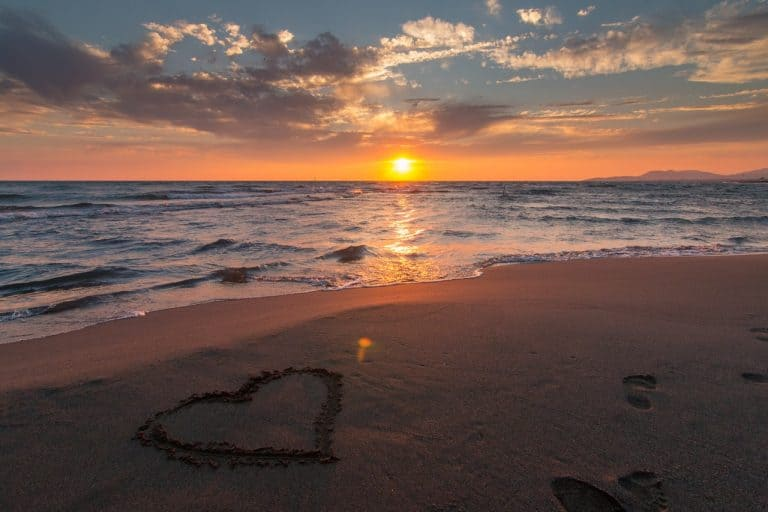 Beach with heart drawn onto the sand