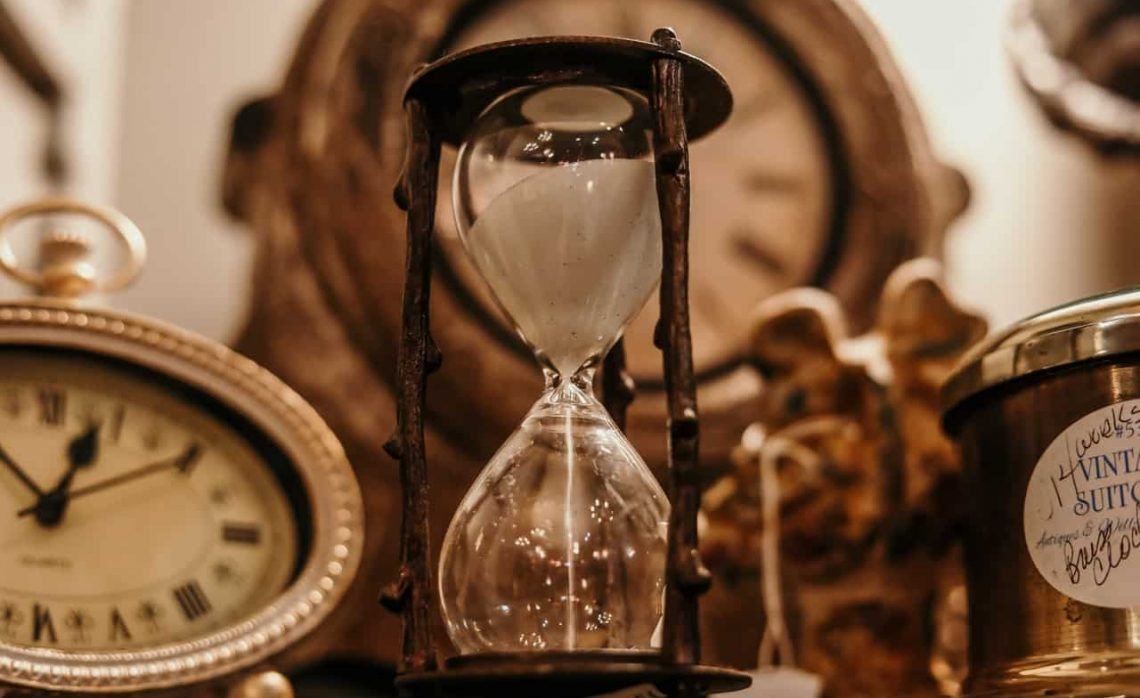 Hourglass and Antique Clock